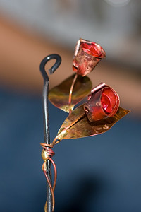 Roses made of copper by an artist in Edinburgh.  EF 85mm f/1.8, Canon 580EX Flash direct.