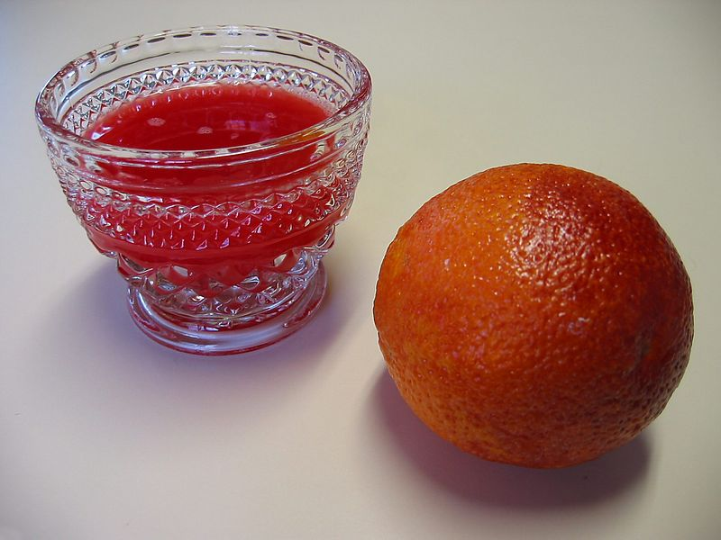 Blood Orange - orange and glass of fresh squeezed juice of 2 oranges