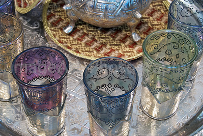 Moroccan glass tea cups on a silver tray