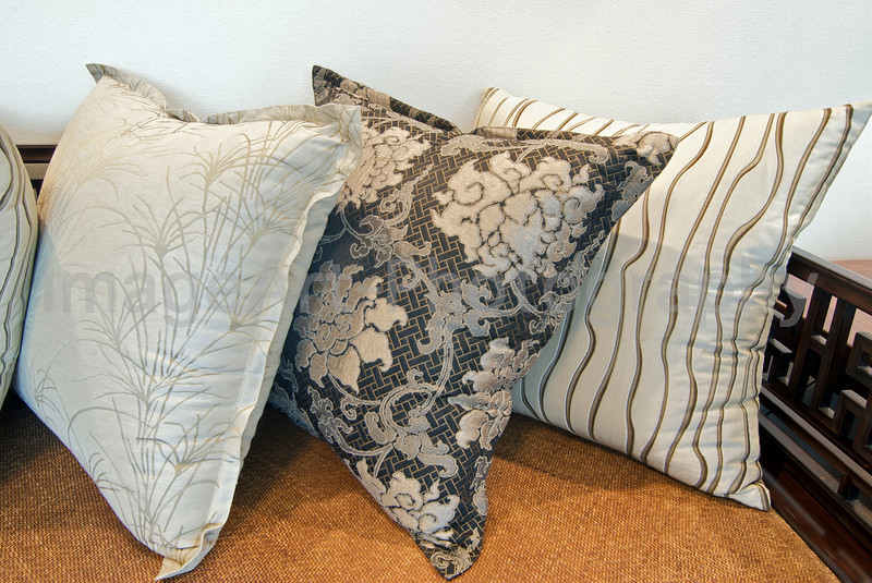 Thai silk cushions on a Chinese day bed