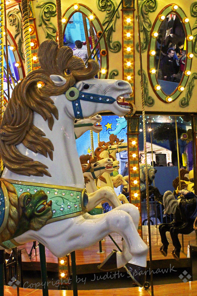 Leaping White Horses ~ Carousel horses, including mirror reflections of the row of horses.  This was from the carousel at Galaxy Land at the West Edmonton Mall, Edmonton, Alberta, Canada.