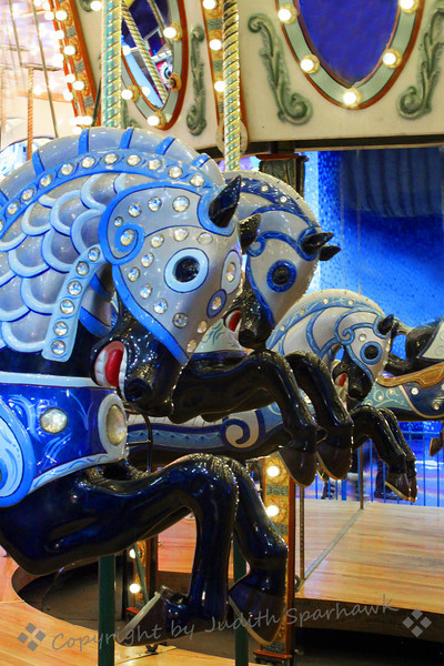 Blacks with Blue ~ Horses with armor on the carousel at West Edmonton Mall.  I liked the repeated pattern of the horses and their prancing forelegs.