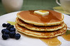 Pancakes with butter, syrup and blueberries