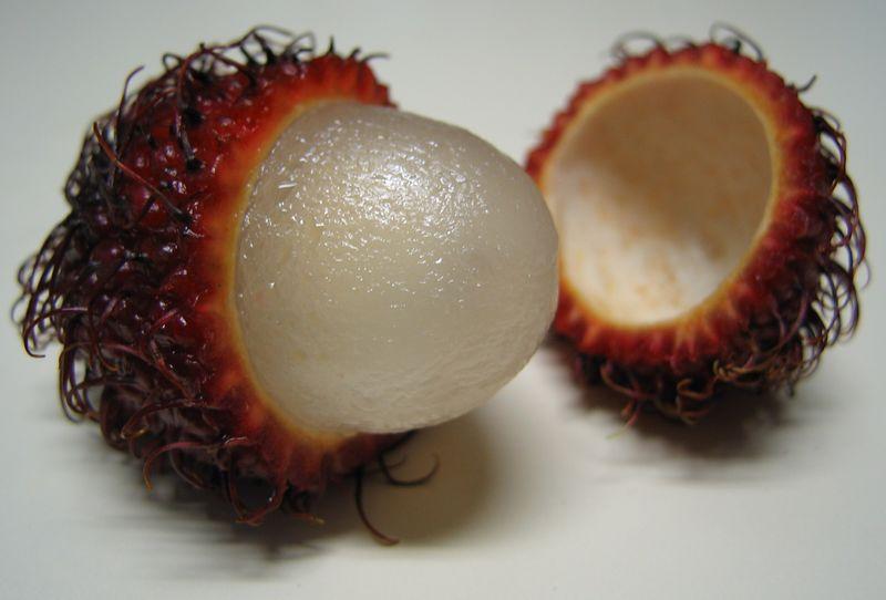 00aFavorite Rambutan cut in half with fruit exposed
