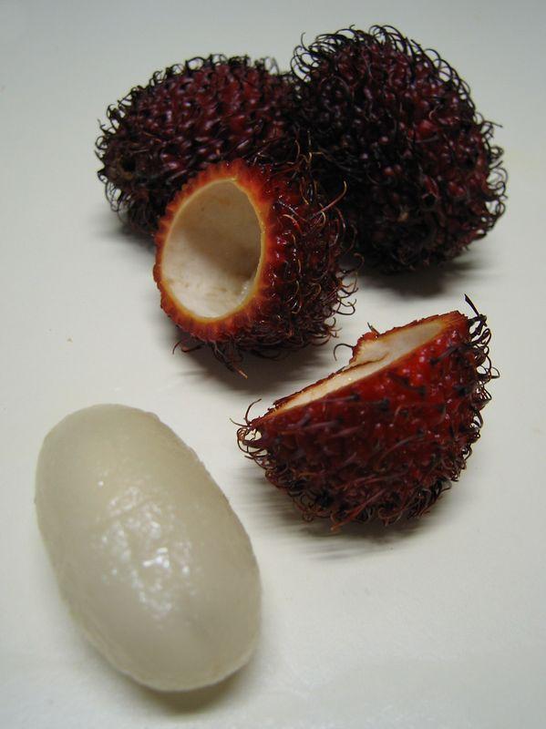One split rambutan with fruit, 2 whole