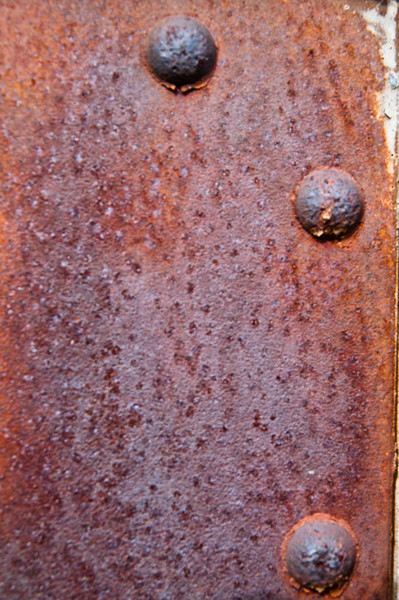 Rust detail with rivets.