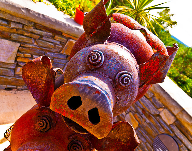 Piglet on two more Pig Grill sculptures.