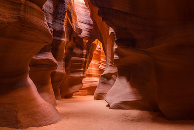 Walking through the passage of time, Antelope Canyon in Page, Arizona. During the summer months there are light rays that fill the caverns adding a divine characteristic to passages. September, 2012.