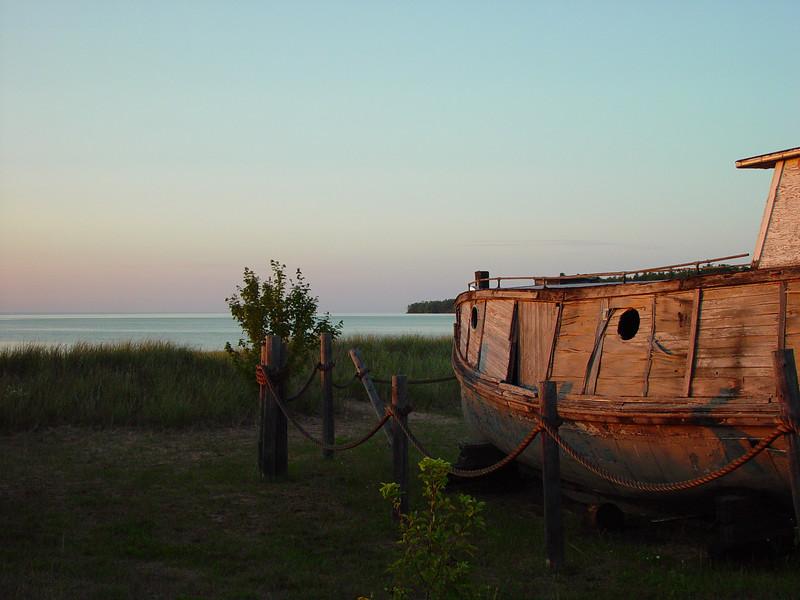 Old fishing boat at sunset, on the Cornucopia beachfront.