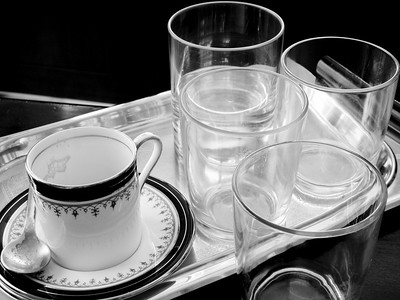 a simple arrangement of an espresso cup and glasses still life