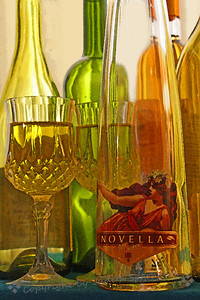 Celebration ~ Fun with wine bottles on a rainy day, loving the jewel-like colors of light coming through layers of glass and wine,