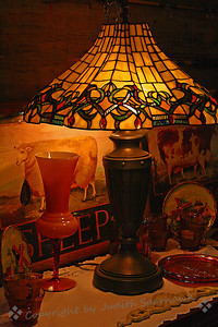 The Lamp & The Sheep ~ A beautiful stained glass lamp at the antique shop along Route 66.  It cast a warm glow on the for-sale items around it.