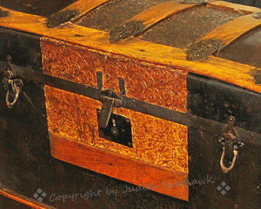 Hope Chest ~ This old chest was in the local antique mall.  I liked its decorative details, including pressed leather and metal fittings.