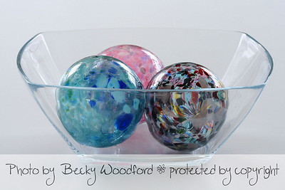 Glass ornaments in bowl