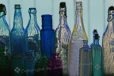 Bottles in the Window ~ These varied bottles were in the window of an antique shop.  I played with filters a bit to try different effects.  I love the colors, shapes and textures.