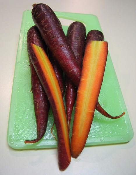 00aFavorite Purple Carrots on light green cutting board