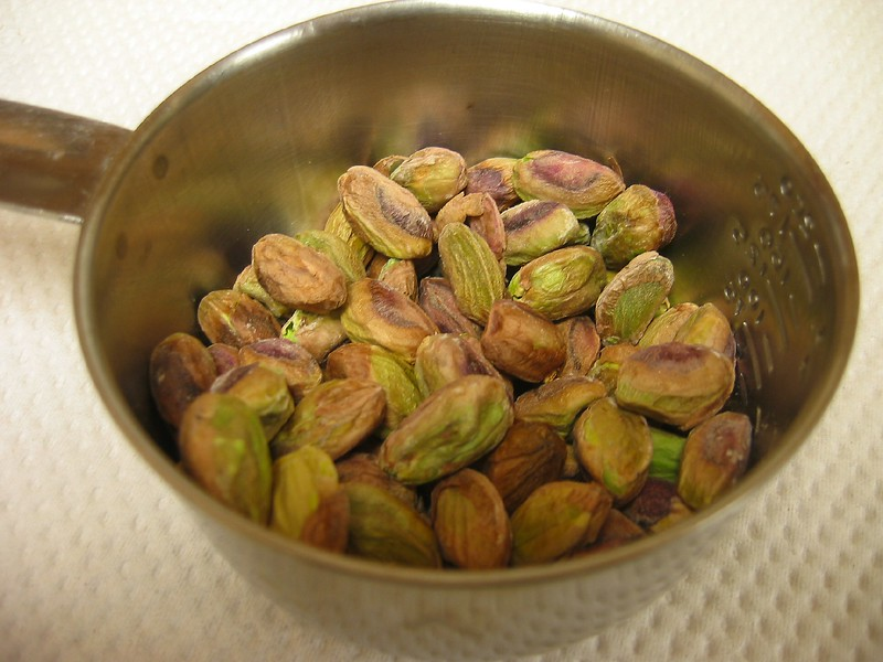 Pistachios in small measuring cup 2