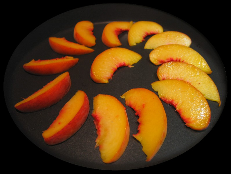 Peach slices being grilled [oval frame]