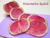 Watermelon Radish slices on pinkish purple cutting board [text]