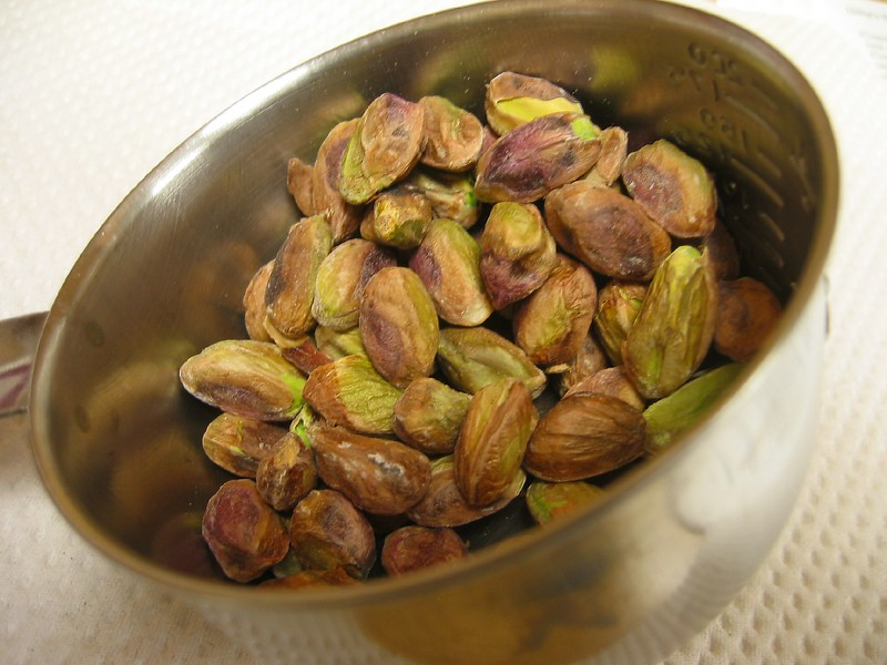 Pistachios in small measuring cup