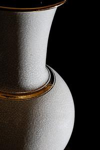 Crackle glaze vase with gold lustre trims and black interior.