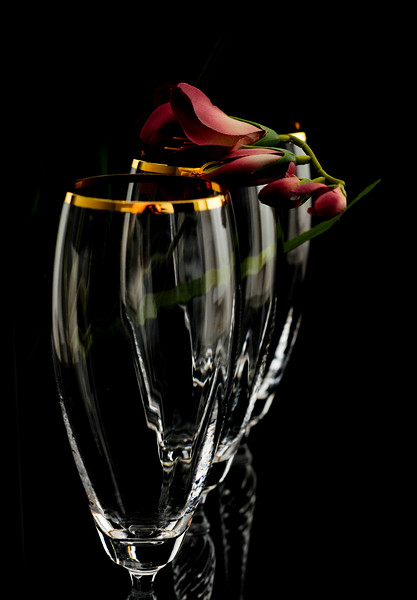 black background, champagne flutes, with flowers