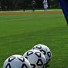 three soccer balls