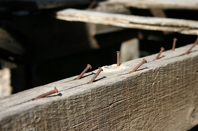 Nails in an old abandoned house, alongside highway