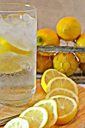 Cold Glass of Water with Slice of Lemon