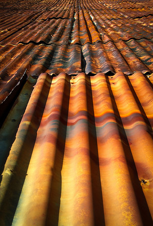 The colours of the passage of time. Rusted iron sheeting.