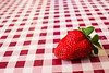 Strawberry on Checkered Tablecloth