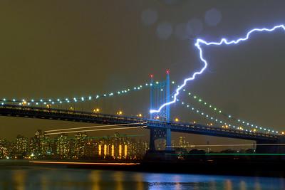 Lightning striking the RFK Bridge, few seconds, before it start pouring non stop for hours in Astoria.