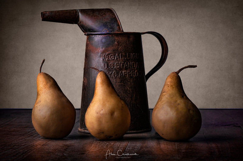 Pears and old water can