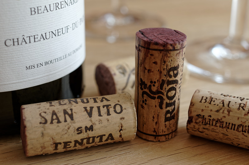 Four corks, two glasses, & a bottle