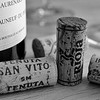 Four corks, two glasses, & a bottle (b/w)