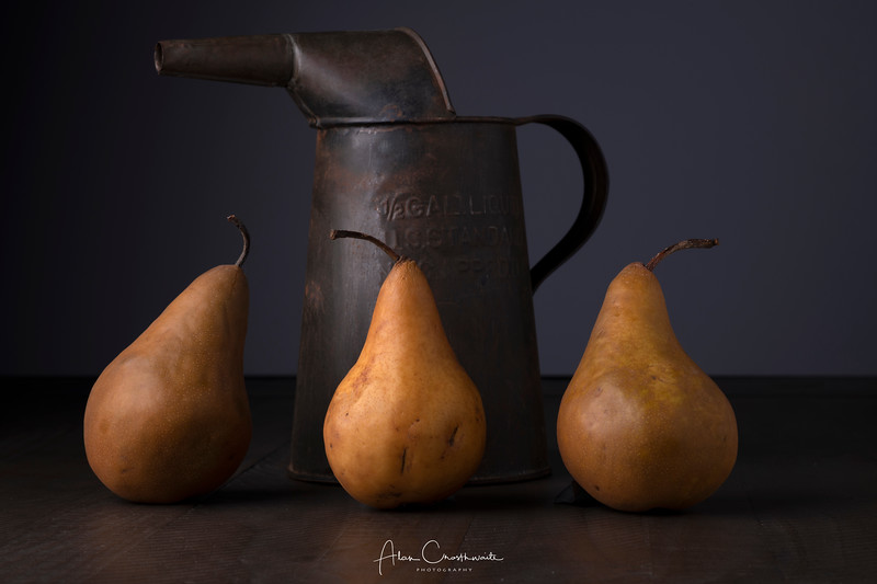 Old watercan and pears