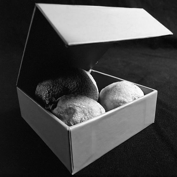 Rotten citrus in a box