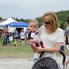 Allison Clifford and Jaiden Mendez, 10 months, enjoy some live music during the Stillman Farm Country Fair in Lunenburg on Saturday afternoon. SENTINEL & ENTERPRISE / Ashley Green