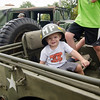 Christopher Kasparian, 1, tries on an Army helmet during the Stillman Farm Country Fair in Lunenburg on Saturday afternoon. SENTINEL & ENTERPRISE / Ashley Green