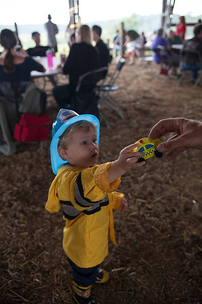A boy shares his toy car during a cookout at Braeburn and Cane Creek Farms in Snow Camp, NC. The event  benefitted the Silent Warrior Scholarship Fund and Green Beret Foundation.