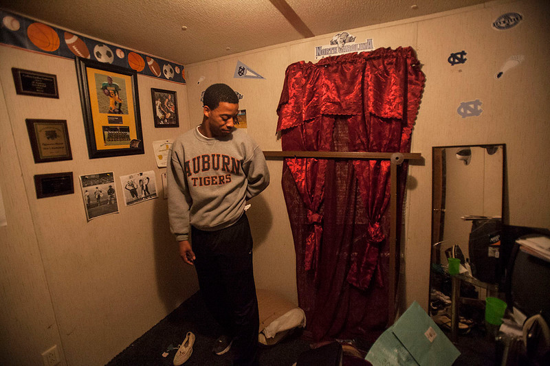 Deshawn High, a star athlete at his high school, looks around his small room in the trailer home he shares with his mother. He wonders how he's going to fix his broken bed.