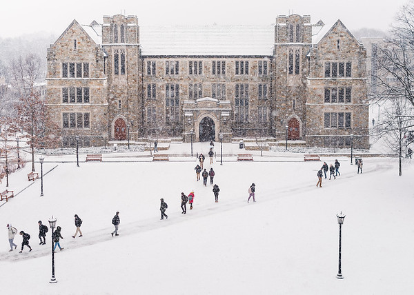 Depicts students crossing the quad in front of Fulton Hall.