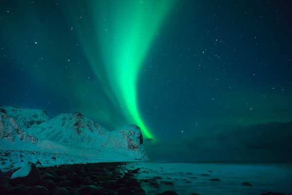 THE NORTHERN LIGHTS ABOVE A NORWEGIAN COASTLINE. 2012