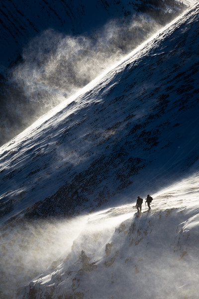 Kiviok Hight and Dustin Roe searching for rams seeking shelter from the helacious winds in the Canadian Rockies.