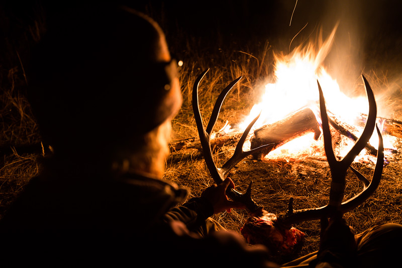 Steven Drake admiring his Montana mule deer buck at 12:30 AM after a 3 hour pack out back to camp.