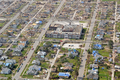 Aerial photographs Joplin Missouri tornado damage and recovery efforts.