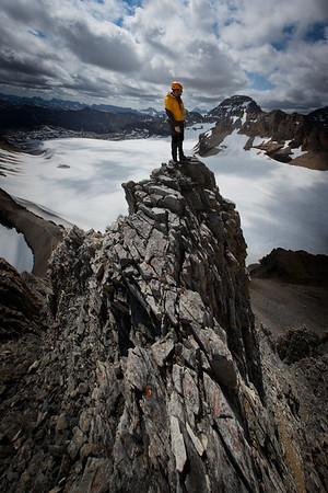 Greg on a steep outcropping below the summit of Mt Bowlen.