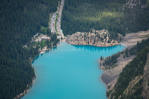The day is in full swing down below at Moraine Lake - car park is already full and canoes are out.