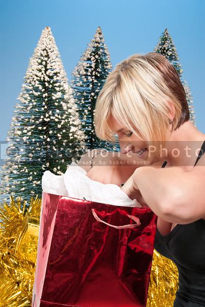 A beautiful woman holding a Christmas gift present bag