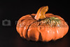 A ceramic pumpkin, harvest or halloween fall decoration.